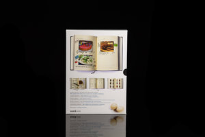 My Family Cookbook. Black hardback notebook with slip case packaging (back). Shown on black background.