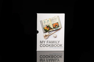My Family Cookbook. Black hardback notebook with slip case packaging. Shown on black background.