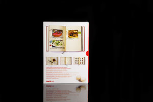 My Family Cookbook. Red hardback notebook with slip case packaging (back). Shown on black background.