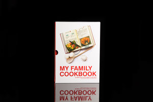 My Family Cookbook. Red hardback notebook with slip case packaging. Shown on black background.