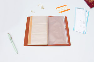 PU Leather Travel Notebook open on desk with pockets