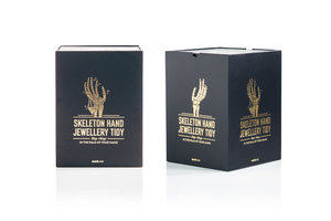 Gold foil packaging design by SUCK UK for skeleton hand.