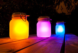 pink yellow blue sun jars on park table