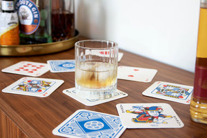 Glass of whiskey on playing card drink mats