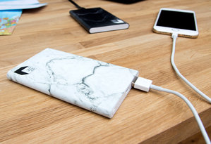 Sleek grey marble power bank for friends and workmates
