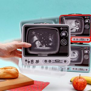 Hand holding tin TV Lunchbox with moving image