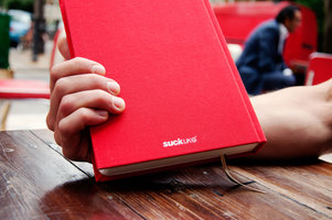 Hardback red cloth cover blank recipe book.