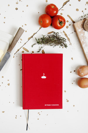 My family cookbook with red cloth hardbound cover.