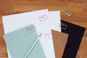 Shiny rose gold envelope paper clips