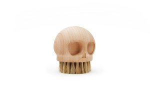 solid beech wood brush shaped like a skull