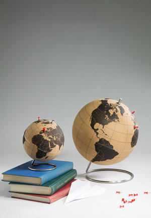 small and large cork globes on table