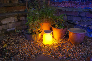 solar light jar in garden lighter