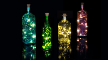 Rechargeable LED String lights shown in colourful bottles