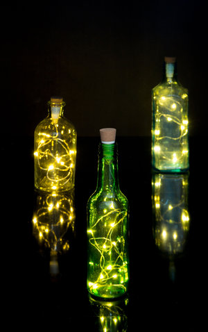LED String lights displayed in colourful glass bottles