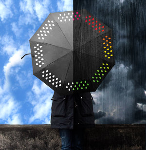 Clever umbrella changes colour when in rains. Showing dry and wet conditions.