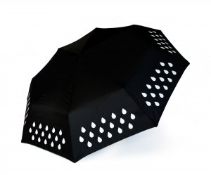 Black umbrella. Changes colour when in rains. Showing the simple white design before it has contacted with water.