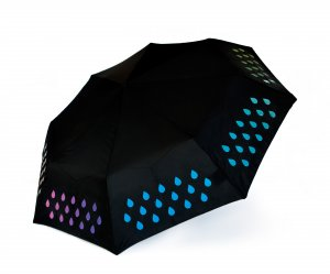 Black umbrella. Changes colour when in rains. Showing the colourful pattern revealed when it gets wet.