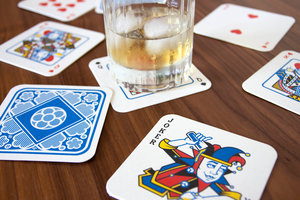 Paper beer mats printed with a deck of cards
