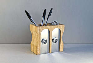 wooden desk tidies with stationery