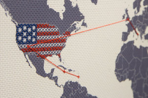 embroider world map with america stitched closeup