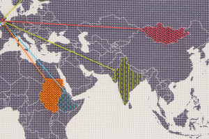 world map embroidery closeup